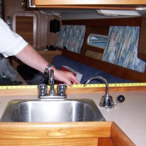 Installed fresh water pump on the galley sink.  Serves as backup should the 12V fresh water pump ever pack it in.