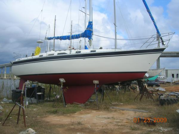 A LOT of sanding, Epoxy primer, and Interlux Perfection topside, a