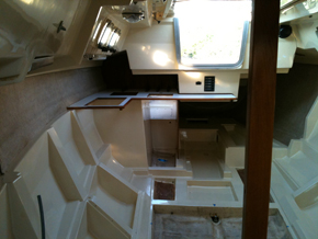 Looking aft with both bulkheads, the cabin sole and much of the galley furniture removed.